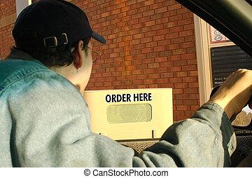 ordering - man ordering at a drive thru