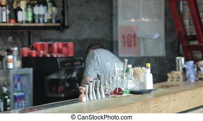 Man orders beer at the bar