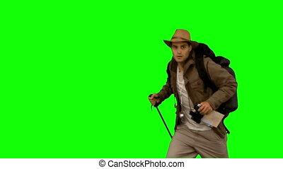 Man orienteering while holding a hi