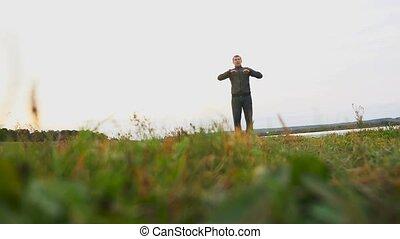 man outdoors playing sports yoga gymnastics healthy...