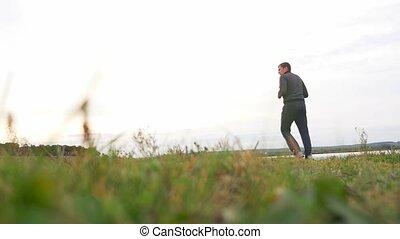 man outdoors playing sports yoga gymnastics healthy sport...