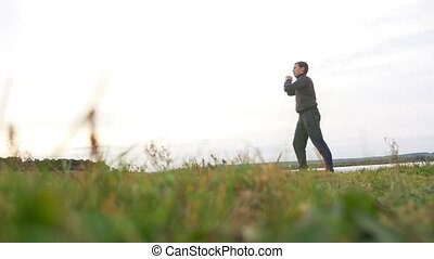 man outdoors playing sports yoga sport gymnastics healthy...