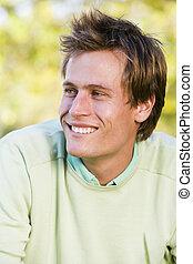 Man outdoors smiling