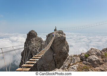 Man over chasm - Man crossing the chasm on the hanging...