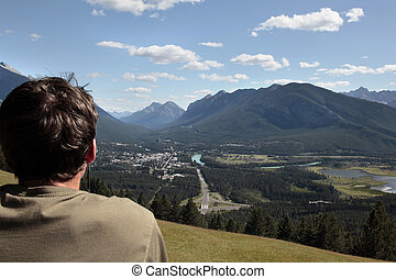 Man overlooking mountains and town of Banff