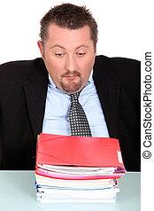Man overwhelmed by paperwork
