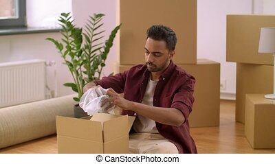 man packing boxes and moving to new home - moving, people...