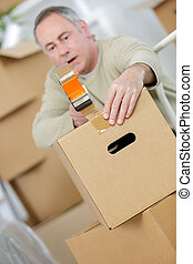 man packing boxes close-up