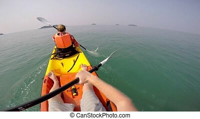 Man paddling in Kayak on sea.