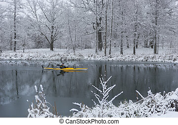 Man paddling in yellow kayak in river in winter - Man ...