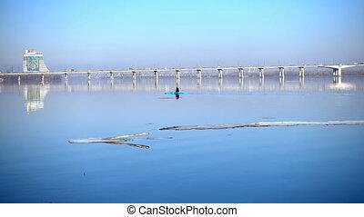 man paddling on a kayak at the Dnipro river at the spring...