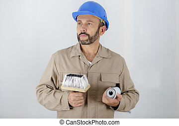 man painter with tools in hands