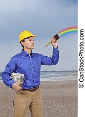 Man painting a rainbow