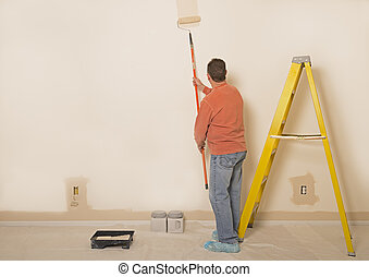 Man Painting A Wall / Copy Space To The Left