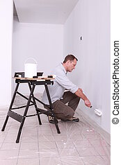 Man painting a wall