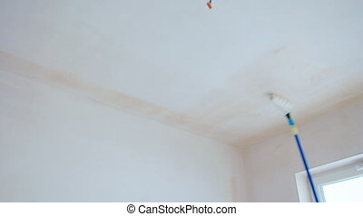 Man Painting the Room - Man painting the room white. ...