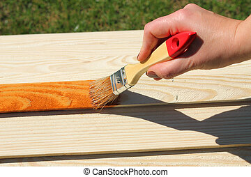 painting wooden furniture piece - Man painting wooden ...