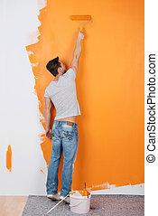 Man paints a wall