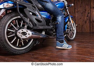 Man parking his motorbike