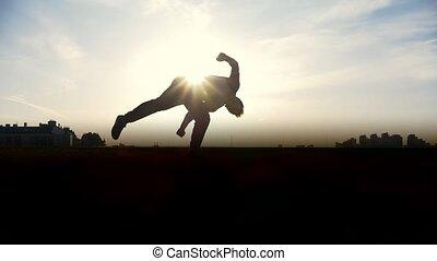 Man Parkour tricker jumper performs amazing flips,...