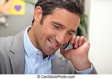 man passing a phone call