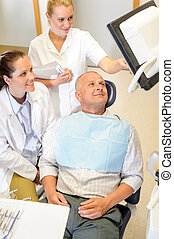 Man patient at dental consultation dentist surgery