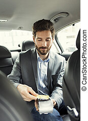 Man paying the taxi with the credit card. NFC technology