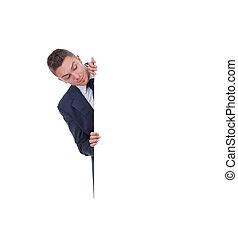 Portrait of a man peeking behind empty white billboard