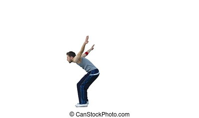 Man performing a back-flip in slow motion against a white...