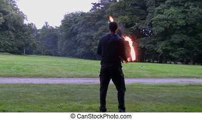 Man performing fire tricks - Party entertainer juggling...