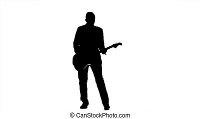 Man performs a concert on electric guitar. Slow motion. Silhouette
