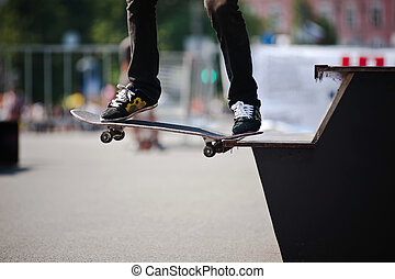 man performs a skateboarding trick in the park