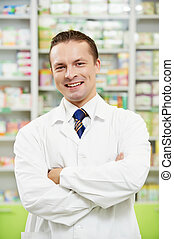 Man pharmacy chemist in drugstore