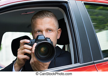Man Photographing With Slr Camera From Car - Close-up Of A...