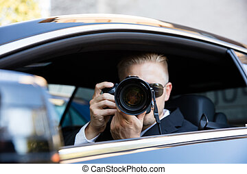 Man Photographing With SLR Camera - Man Sitting Inside Car...