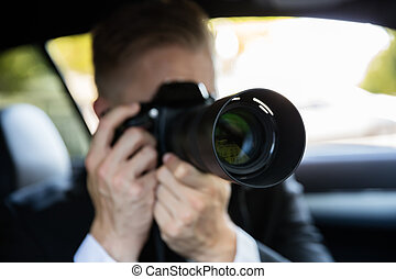 Man Photographing With SLR Camera - Private Detective...