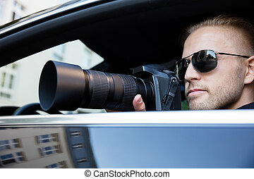 Man Photographing With SLR Camera