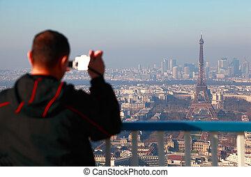 Man photographs of panorama of Paris with Eif