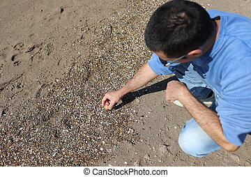 Man Picking Shells