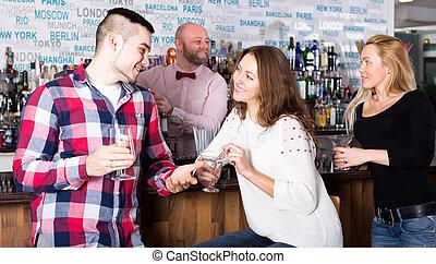 Man picking up woman in bar