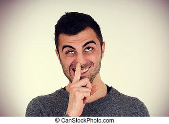 man picks his nose