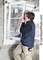 Man placing a window