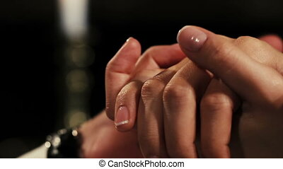 Man placing engagement ring with diamond on woman finger. Proposal. Romantic.
