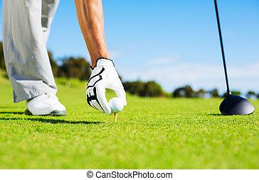 Man Placing Golf Ball on Tee - Golfer Placing Golf Ball on...