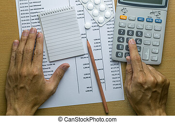 Man planning monthly budget, Finance about health concept