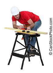 Man planning plank of wood
