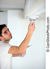 Man plastering a ceiling
