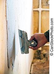 Man plastering wall