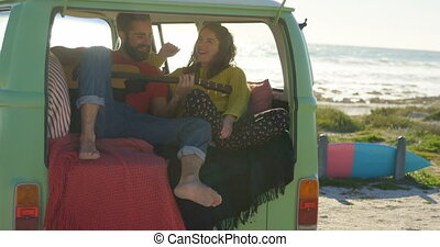 Man play guitar for woman in the van 4k - Man play guitar ...