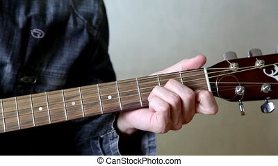 man play in guitar